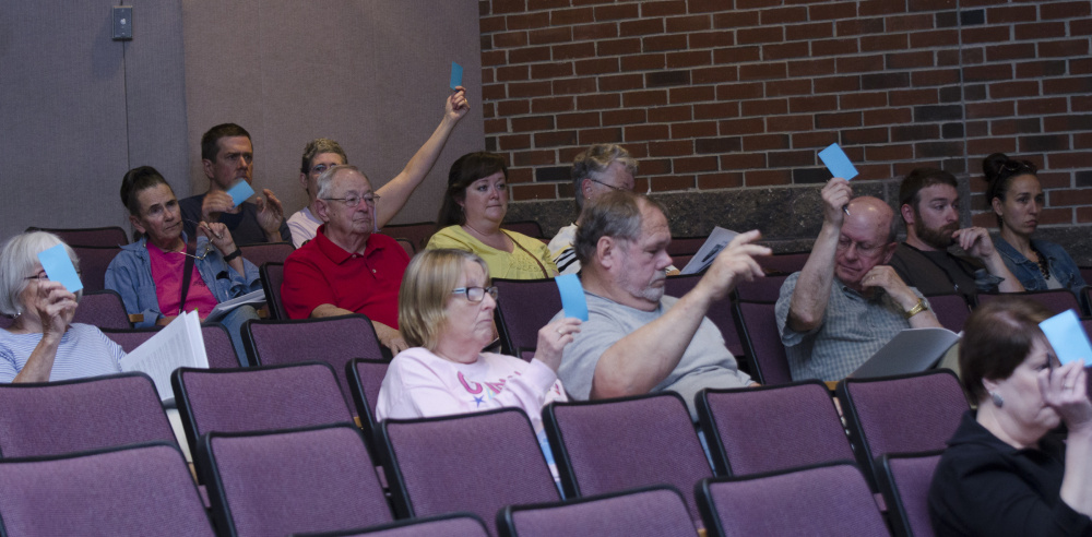 Farmingdale residents vote Saturday during Town Meeting at Hall-Dale High School in Farmingdale.