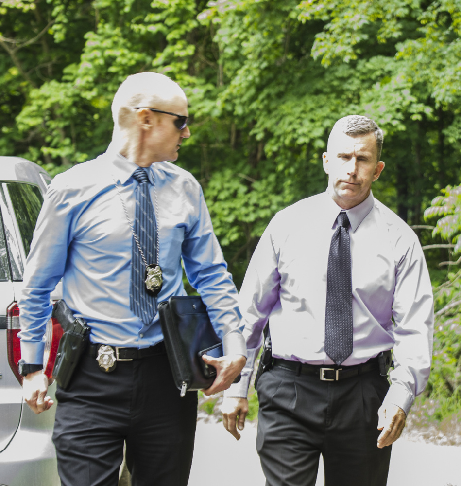 Benjamin Sweeney, left, and Sgt. Christopher Tremblay, both of the Maine State Police, confer on Saturday at the scene of a fatal shooting off Yeaton Drive in West Gardiner, Police said the victim, James Haskell, 41, was a visitor at the property, according to Steve McCausland, spokesman for the Maine Department of Public Safety. McCausland said police have interviewed the alleged shooter, but because it has not been determined a crime was committed, the person is not currently considered a 'suspect.'