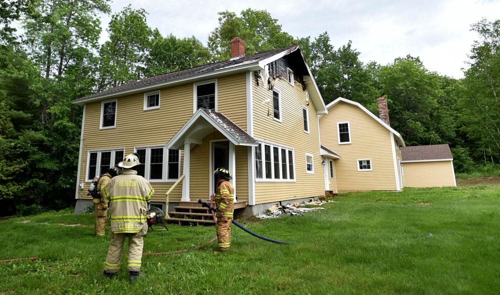 Firefighters from multiple agencies fought a house fire Thursday at 1191 Lakeview Drive in China.