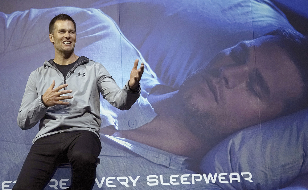 New England Patriots quarterback Tom Brady gestures during a promotional event Thursday in Tokyo. The Super Bowl-winning quarterback is on a week long promotional tour of China and Japan for a sportswear maker.