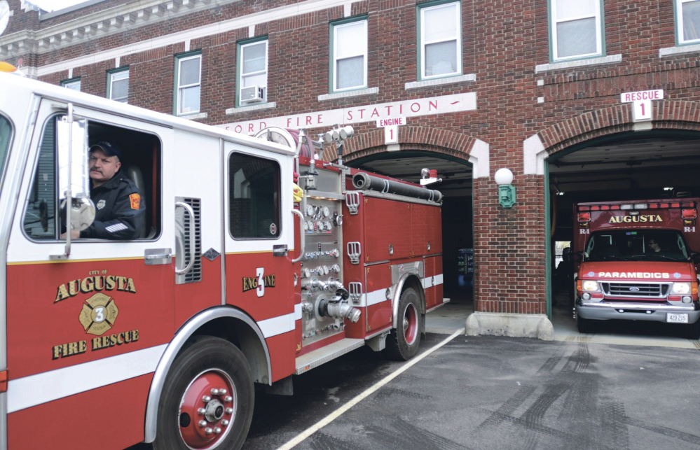 An Augusta firefighter backs a truck into the Hartford Fire Station in this file photo.