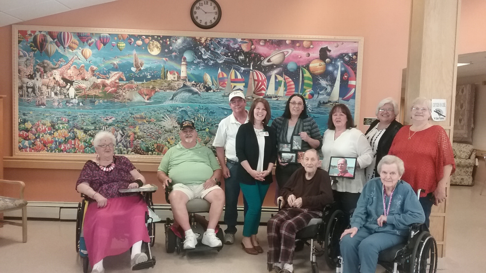 Front, from left, are Mildred Richardson, resident; Richard Poissonnier, family; William Brown, resident; and Fay Bickford (resident). Back, from left, are Rick Stewart, brother; Shannon Lockwood, administrator; Deanna Roberge, family; Janine Stewart, wife;  Lucinda Poissonnier, family; and Margaret Stewart, family.
