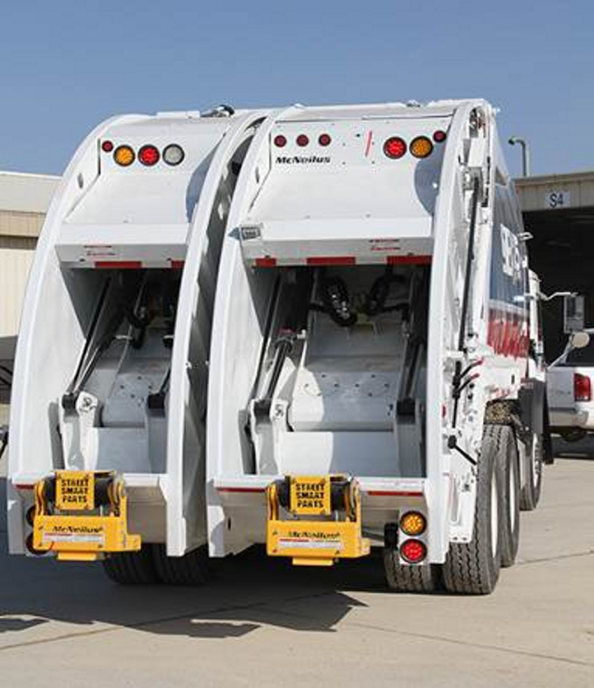 This is an example of a split packer truck that can take both recyclables and trash.
