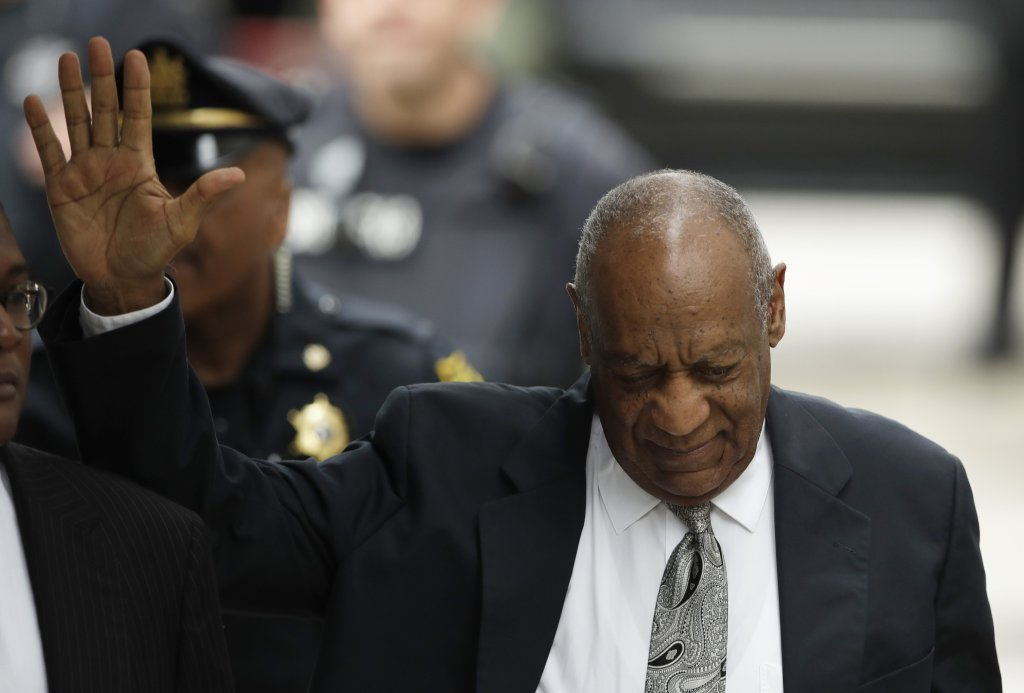 Bill Cosby waves as he arrives at the Montgomery County Courthouse for his sexual assault trial on Saturday in Norristown, Pa.