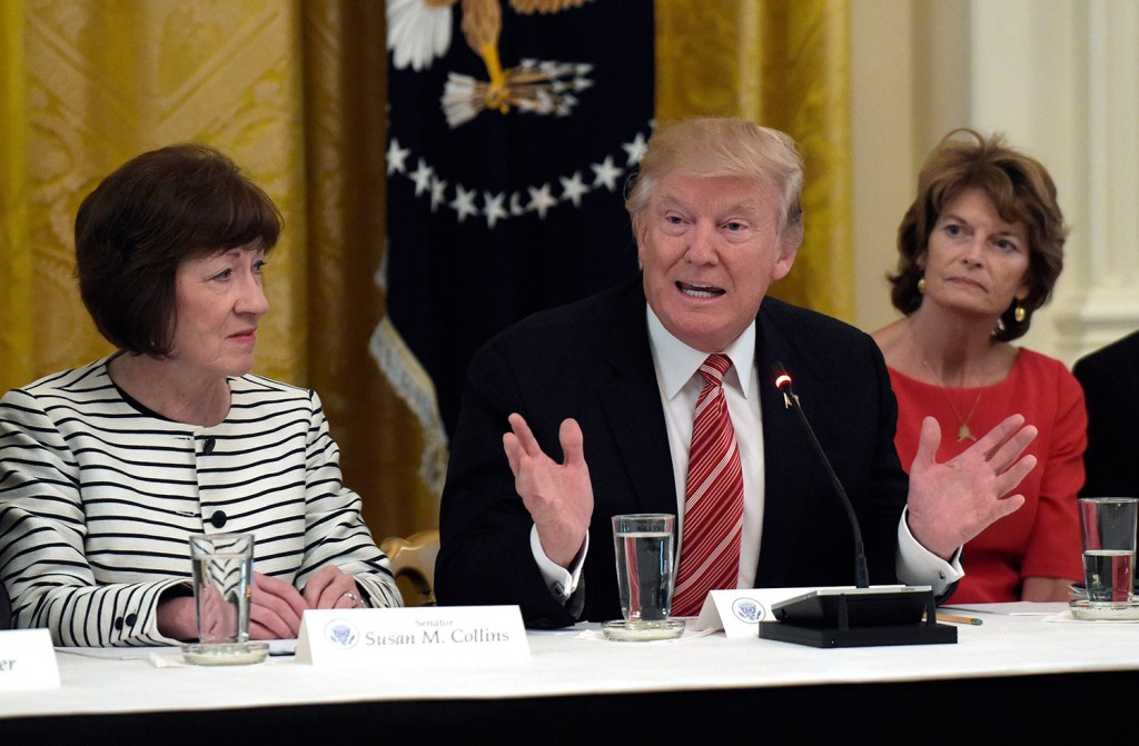 President Trump speaks as he meets with Republican senators on health care at the White House on Tuesday. Sen. Susan Collins, R-Maine, left, and Sen. Lisa Murkowski, R-Alaska, right, listen. Collins opposes the health care bill proposed by Senate Republican leaders.