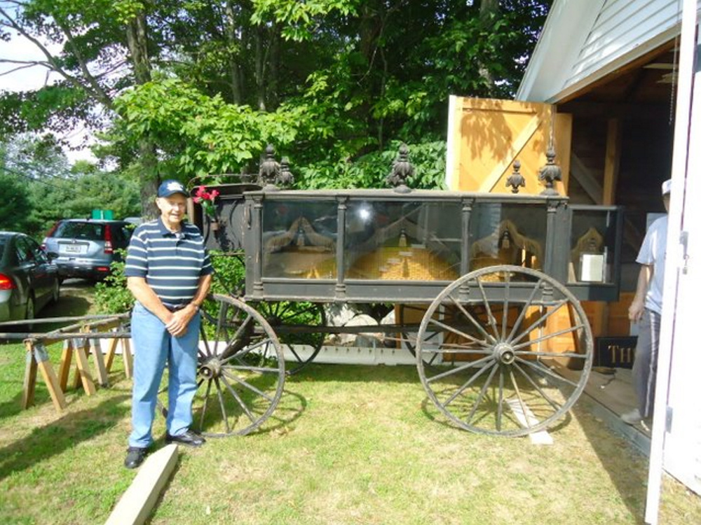 Ralph Bond stands beside his grandfather's (S.H. Bond) 1800's horse-drawn hearse which will be on display at the Saturday, Aug. 5 Open House and Exhibit Day at the Old Jefferson Town House.