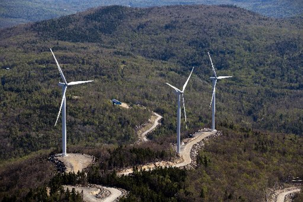 Three wind turbines are seen atop a ridge just south of Webb Lake in this aerial photograph taken May 14, 2015. Plans for new wind turbines in Somerset County may involve ridges in the remote townships of Johnson Mountain, Chase Stream and Misery, just east of Moosehead Lake, as well as Big Moose Mountain ridge line near Big Indian Pond.