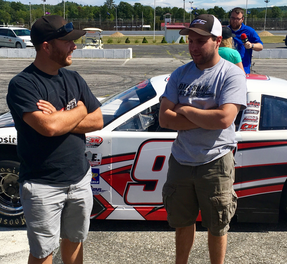 Derek Kneeland, left, and D.J. Shaw discuss the upcoming Oxford 250 during media day Wednesday at Oxford Plains Speedway. The race is Sunday.