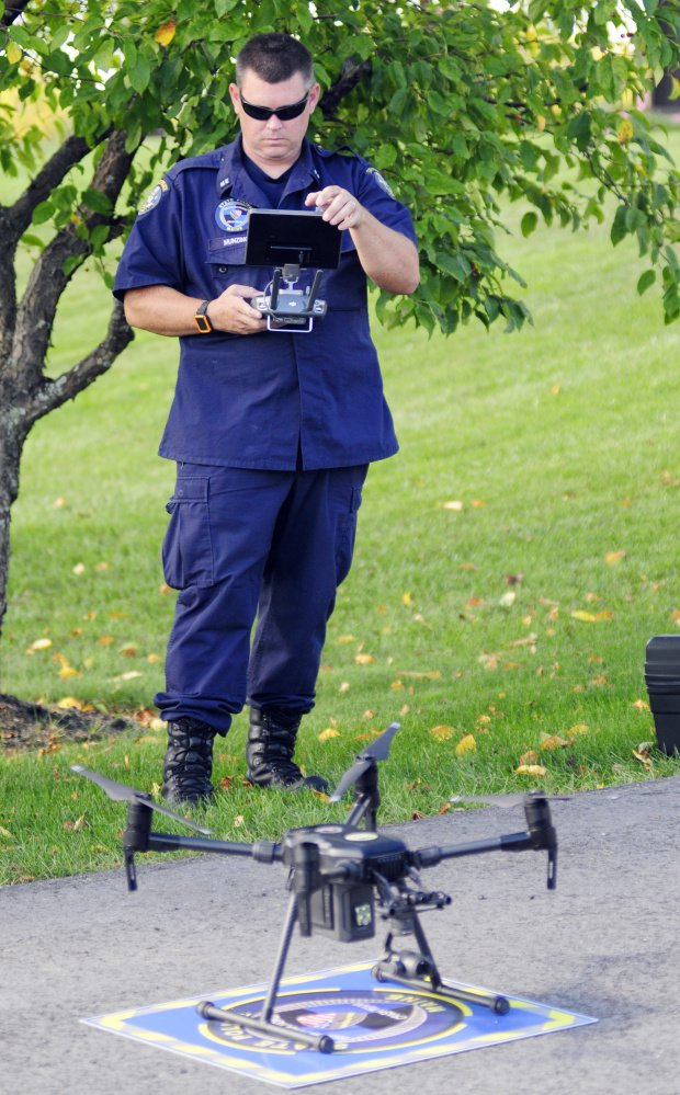 Maine State Police Specialist Patrick Munzing prepares to launch an unmanned aerial vehicle Thursday outside state police headquarters in Augusta.