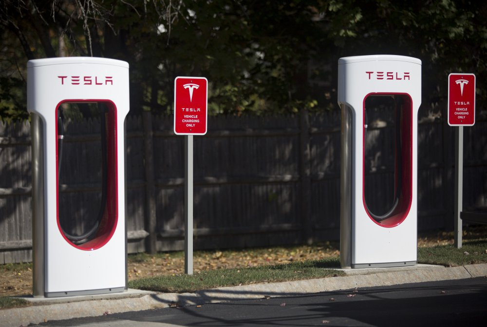 """These are two of the new Tesla Superchargers in the L.L. Bean parking lot off Justin's Way in Freeport. The electric-vehicle charging station will include eight Tesla Superchargers and eight more plugs for all other makes. Mac McKeever, a spokesman for L.L. Bean, acknowledged the public relations value, but said the charging station is """"good for the community, good for customers and good for the environment."""""""