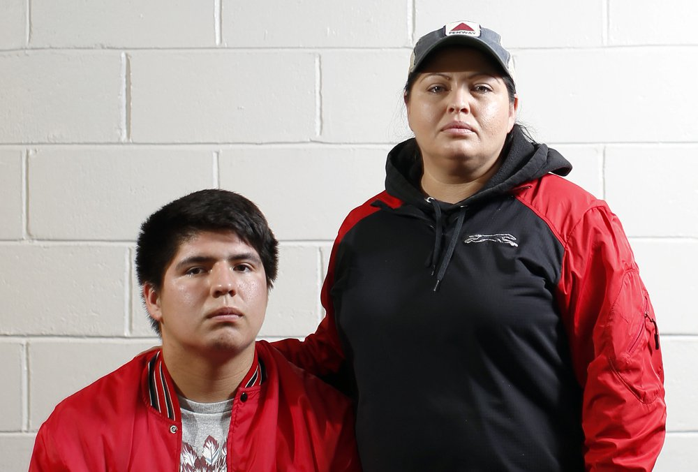 Lisbon High quarterback Lucas Francis and his mother, Amelia Tuplin, are Micmac Indians.