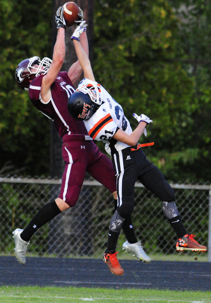 Gardiner defensive back Blaise Tripp plays defense and causes MCI tight end David Young to drop the pass during an exhibition game Aug. 25 at Hoch Field in Gardiner.