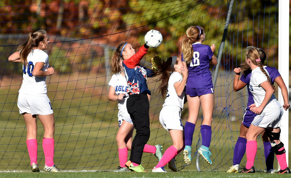 Erskine goalie Taylor Shute makes a save on a corner kick during a Class B North game against Waterville last Friday in South China.