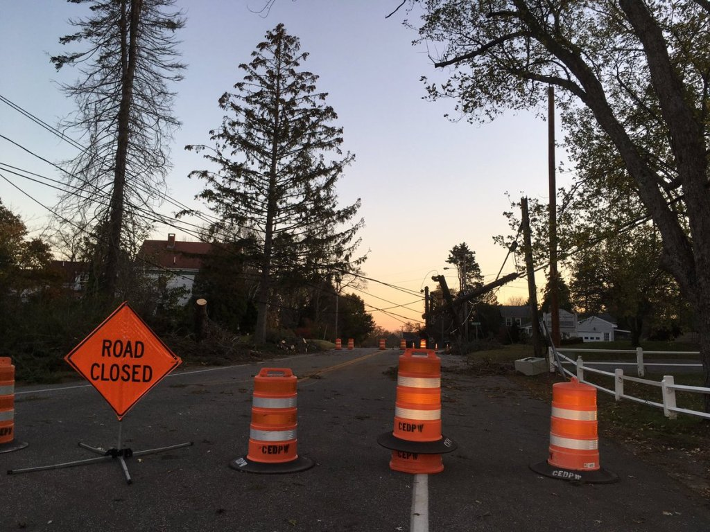 A road in Cape Elizabeth was shut down Monday because of downed power lines. Photo by Jessica Conley, WCSH