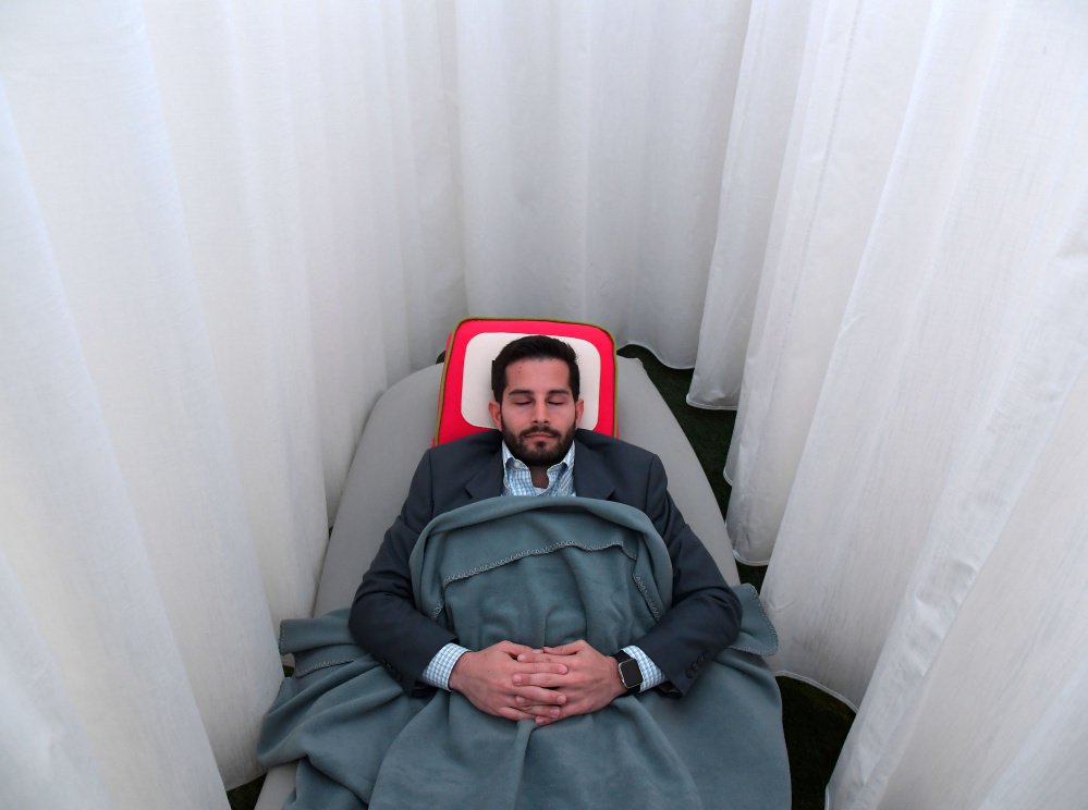An on-the-job napping cocoon at Recharj in Washington, D.C., may leave Daniel Turissini in a fine frame of mind to tackle his afternoon duties.