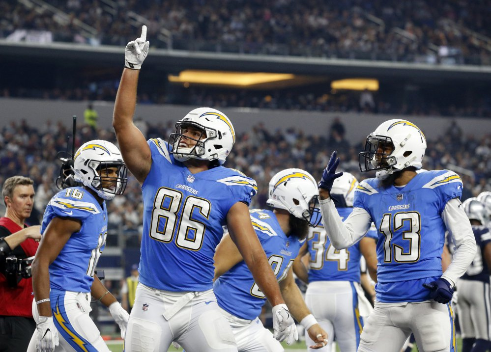 Hunter Henry, center, of the Chargers celebrates his touchdown catch with Tyrell Williams. left, and Keenan Allen (13) in the second half Thursday's game against the Cowboys in Arlington, Texas. TheChargers rolled to a 28-6 win.