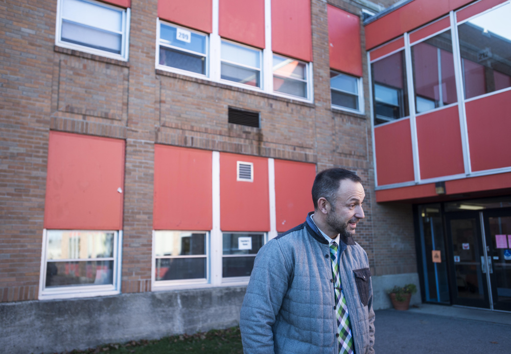 Jason Briggs, principal of Winslow Junior High School stands outside of the school at the end of the school day Nov. 8 in Winslow.