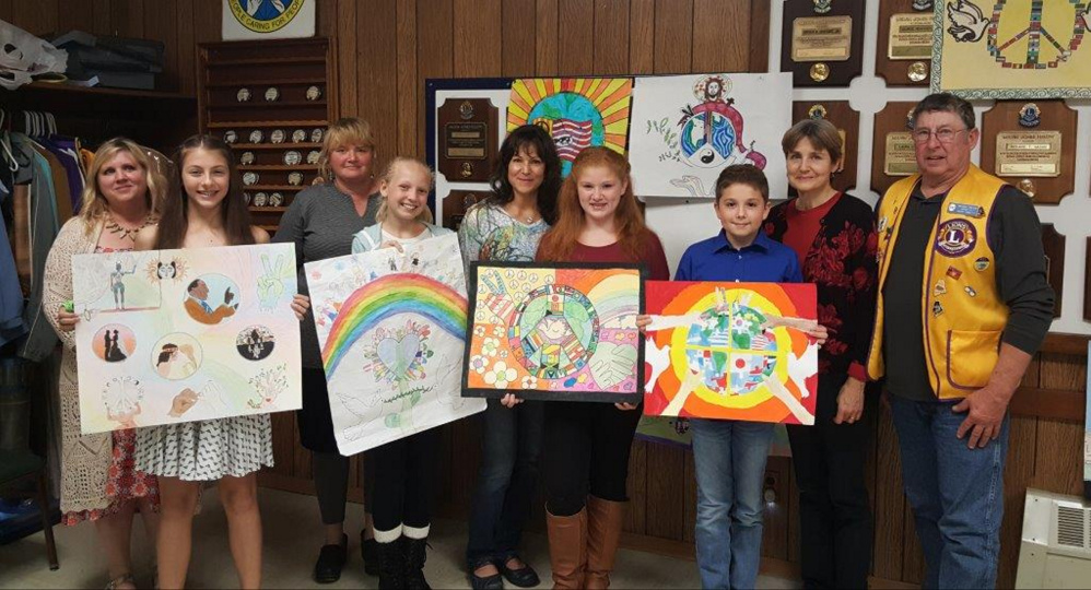 Winners of the Peace Poster Contest with their art teachers, from left, are Holly Hilton and Jenna Perkins, Whitefield; Rachel Richmond and Abby St. Cyr, Jefferson; Sandy Dunn and Liberty Kimball, Chelsea; and Damon Wilson and Jenny Keller, Windsor; and Lion Barry Tibbetts.