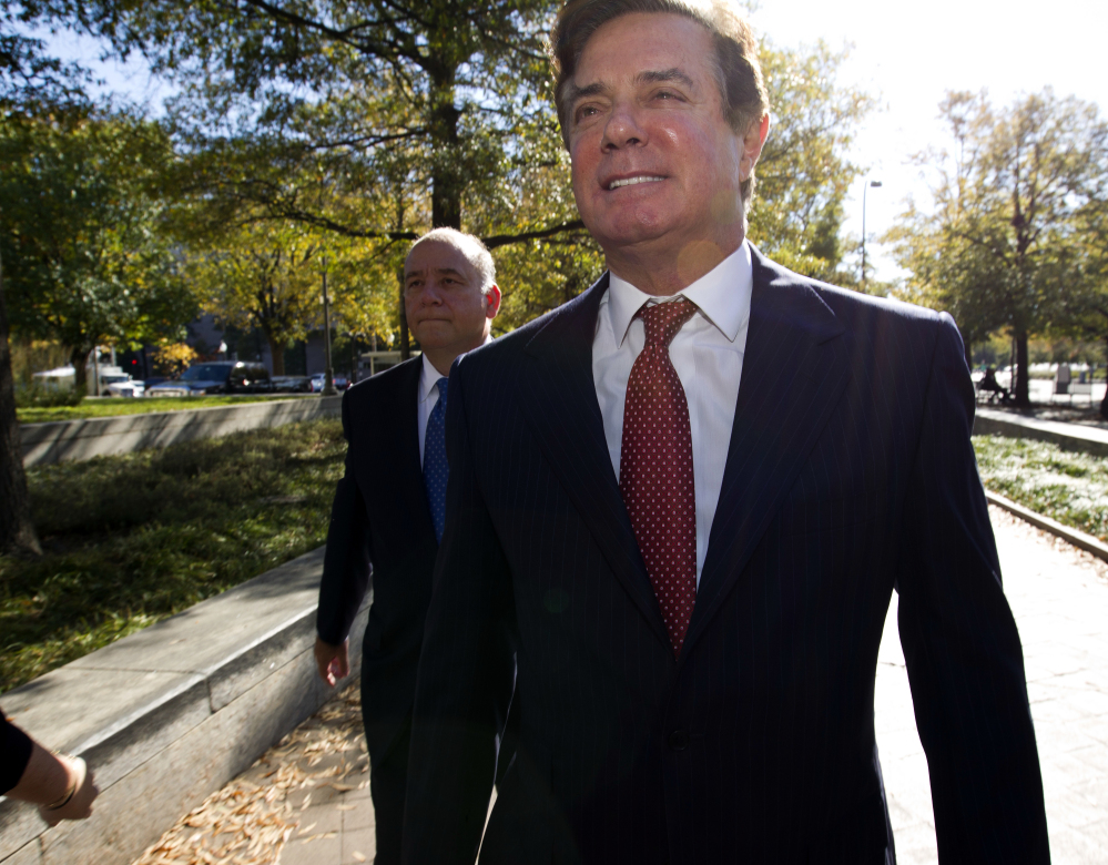 """Paul Manafort arrives at federal court in Washington on Nov. 2. Prosecutors working for Special Counsel Robert Mueller say Manafort has been working on an editorial with a long-time colleague """"assessed to have ties"""" to a Russian intelligence service."""
