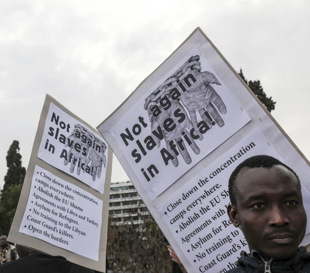 Migrants from Africa take part in a demonstration in Athens protesting EU policy over migration from Africa.
