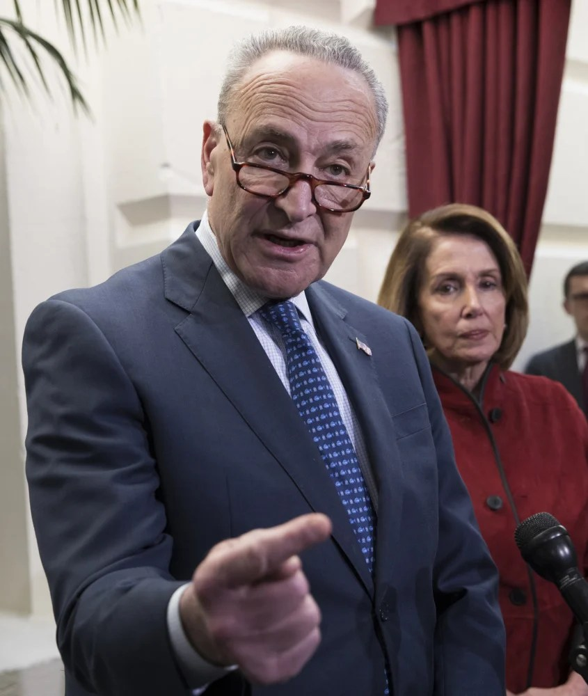 """Senate Minority Leader Chuck Schumer, D-N.Y., seen speaking Dec. 13, said Democrats """"are not going to allow things like disaster relief go forward without discussing some of the other issues we care about."""""""