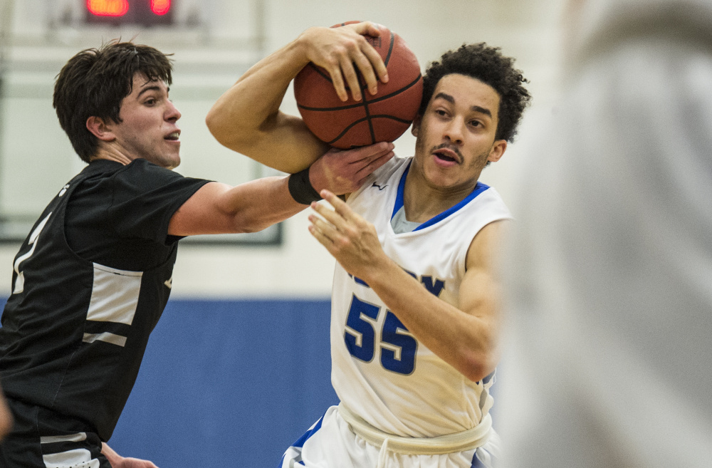 Colby's Wallace Tucker (55) draws the foul from Bowdoin College's Stephen Ferraro (2) on Saturday at Colby College in Waterville.