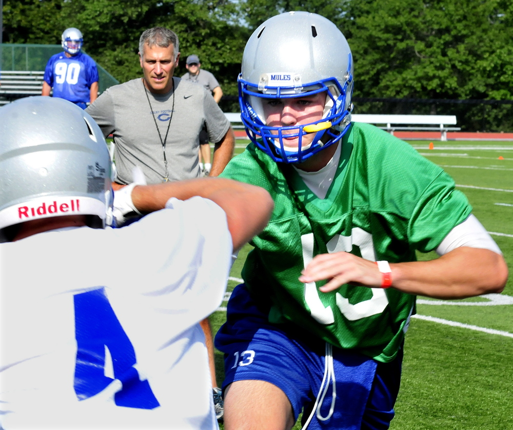 Colby College head football coach Jonathan Michaeles watches his team during a 2014 practice in Waterville.