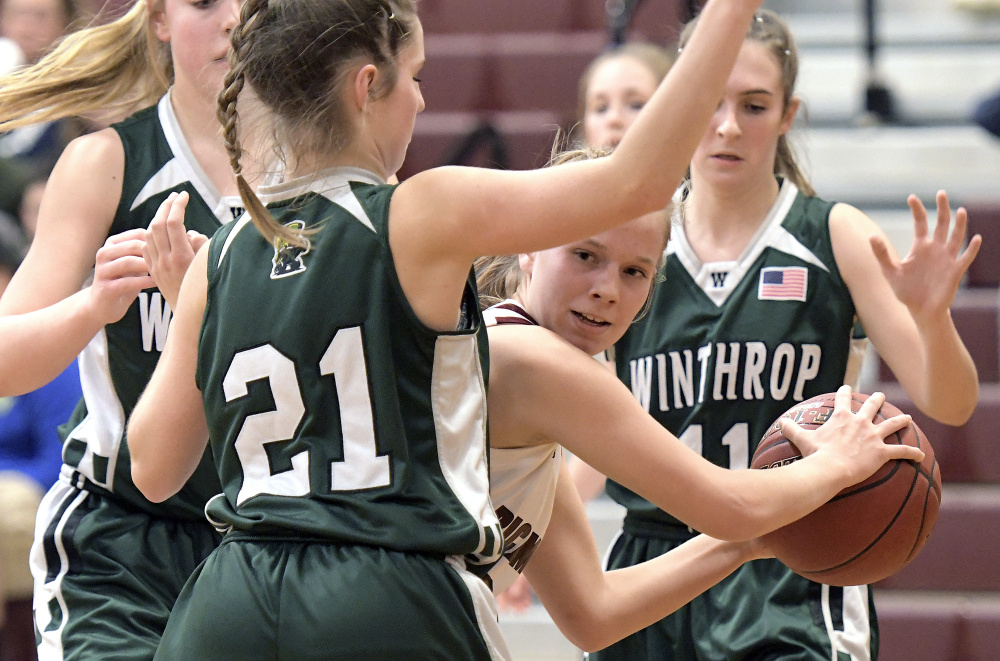 Richmond's Caitlin Kendrick looks for an opening around Winthrop defenders during a Class C South game Wednesday in Richmond.