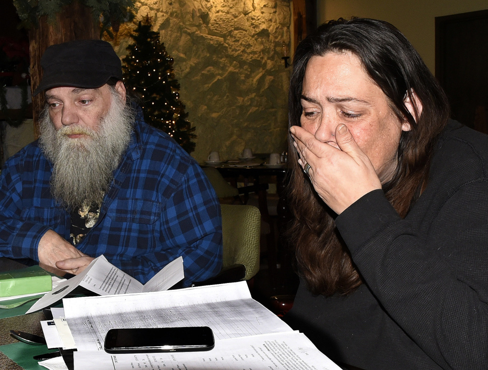 Tammy Baker breaks down and cries while she and her fiancé, Anthony Goepfert, speak on Tuesday at a Waterville hotel about a reported oil spill that made them sick at the apartment they rented at 241 Main St. in Fairfield.