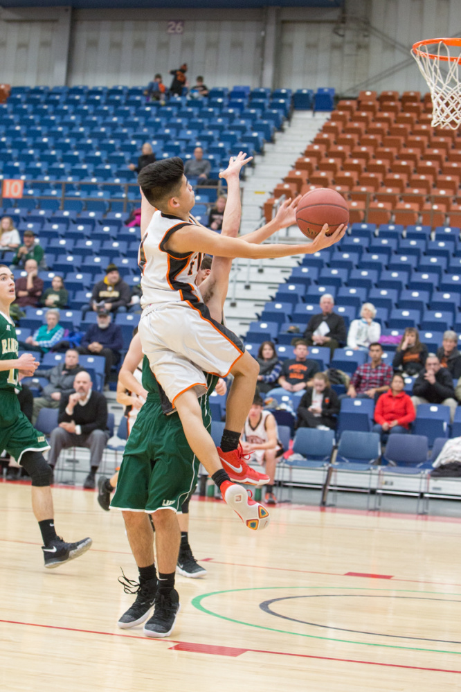 Forest Hills' Kenn Vito Cruz goes up for a shot over Rangeley's Callahan Crosby during the Capital City Hoop Classic on Friday at the Augusta Civic Center.