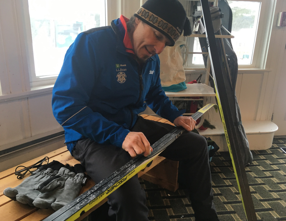 Norm Greenberg of Hanover puts wax on his skis Saturday before going out on the Bethel Village Trails in Bethel.