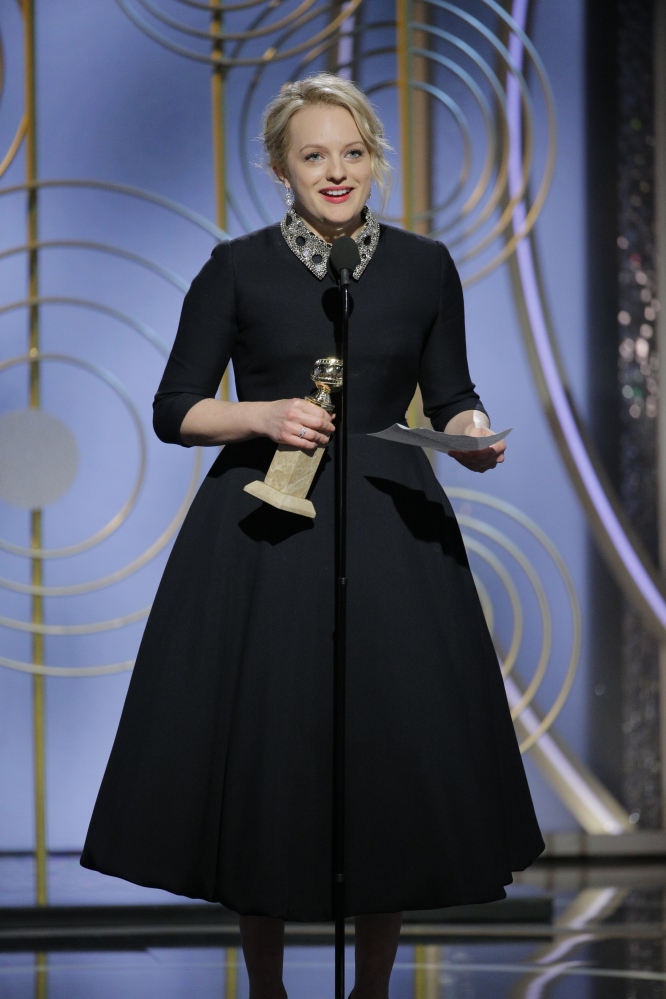 "Elisabeth Moss accepts the award for best actress in a drama series for her role in ""The Handmaid's Tale"" at the Golden Globe Awards in Beverly Hills, Calif., on Sunday."