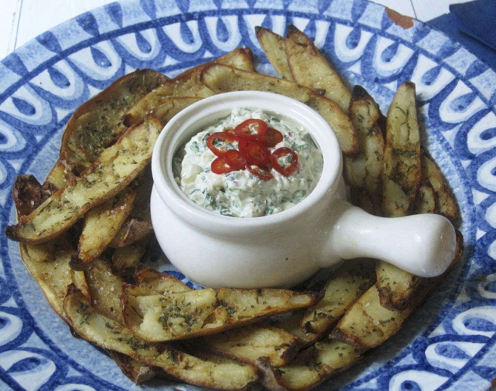 Brush the potato skins with olive oil, mixed with garlic and rosemary, instead of butter for a healthier snack.