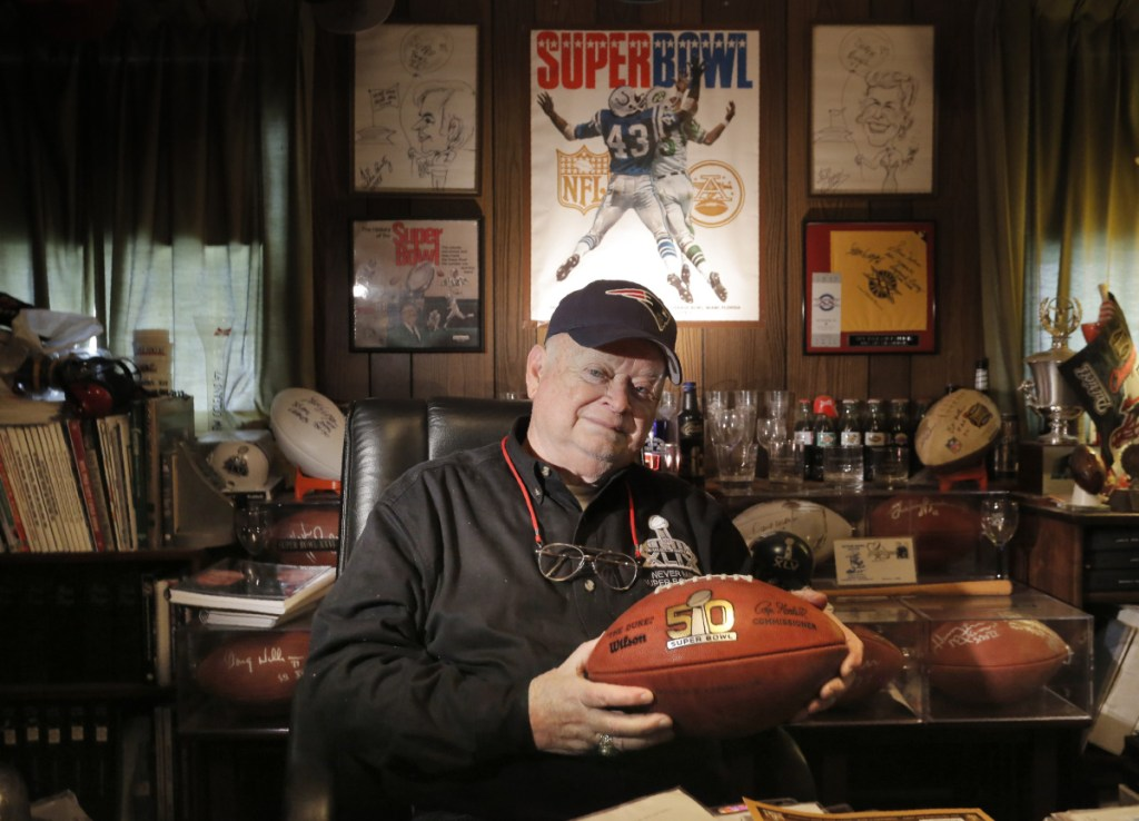 Don Crisman holds a Super Bowl 50 football at his home in Kennebunk in a January 2017 file photo.