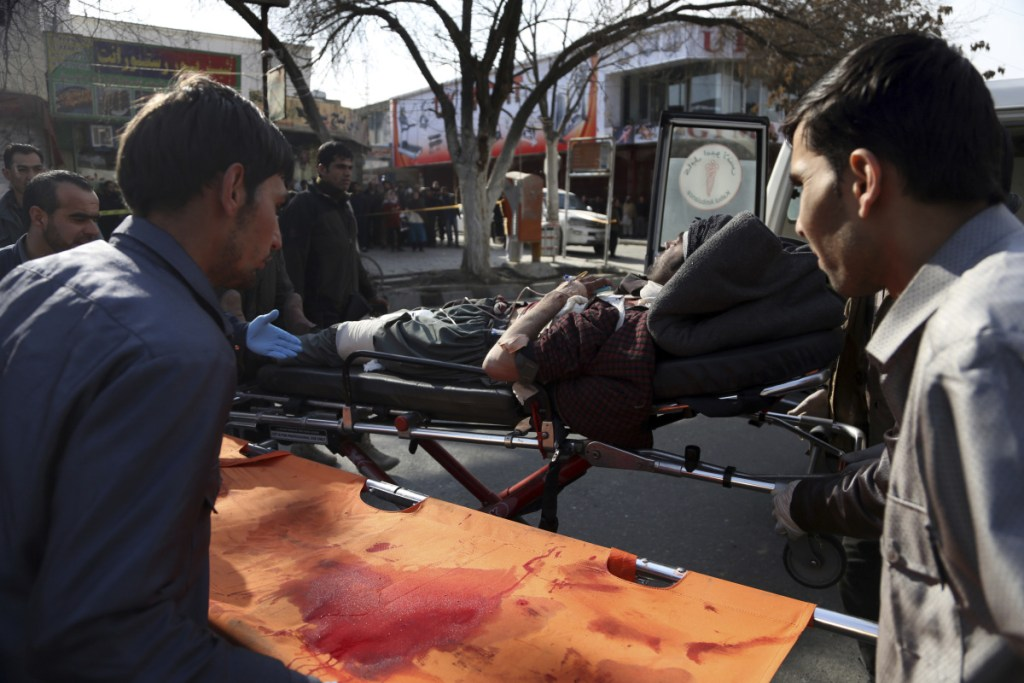 An injured man is moved onto a stretcher outside a hospital after a suicide attack in Kabul, Afghanistan, on Saturday.