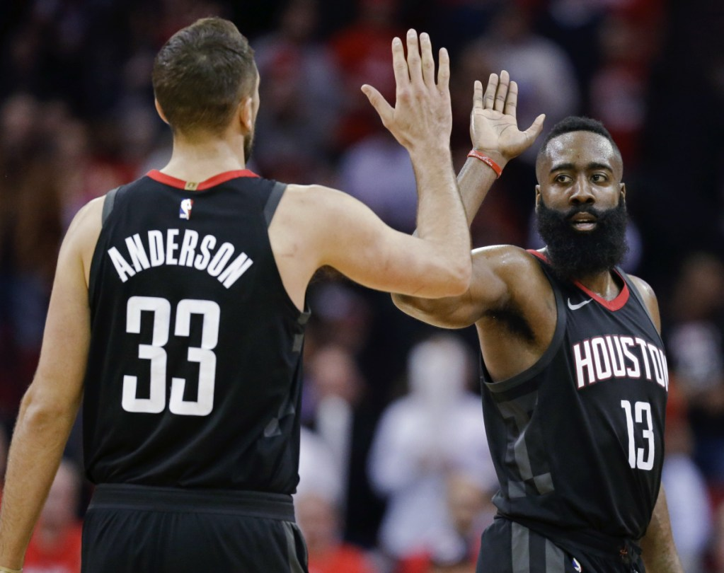 Associated Press/Eric Christian Smith   Houston Rockets guard James Harden, right, high-fives Ryan Anderson late in the second half against Orlando on Tuesday. Harden scored 60 points in a 114-107 Houston win