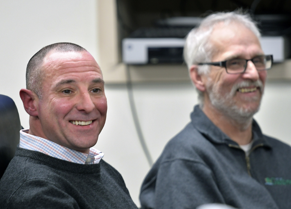 Marc Rines, left, smiles Wednesday after being inaugurated as a Gardiner City Councilor. The son of former mayor Brian Rines and Kennebec County Commisioner Nancy Rines, ran for the seat being vacated by Phil Hart, right, who is stepping down after several decades of service to the community. The swearing in ceremony was held in council chambers in Gardiner.