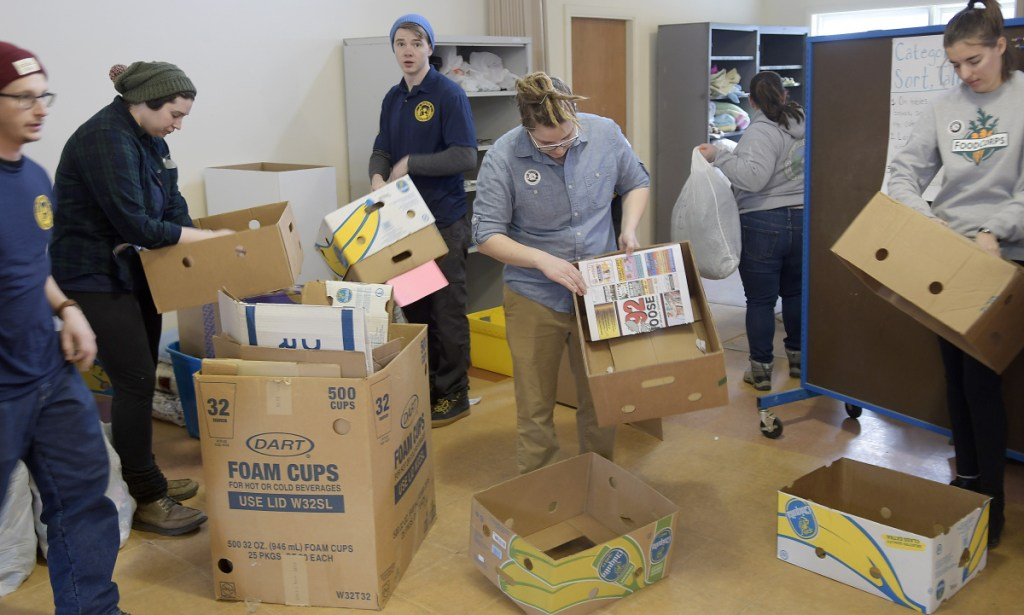 Maine Conservation Corps members volunteer at the Augusta Community Warming Center on the Day of Service for Martin Luther King Jr. on Monday.