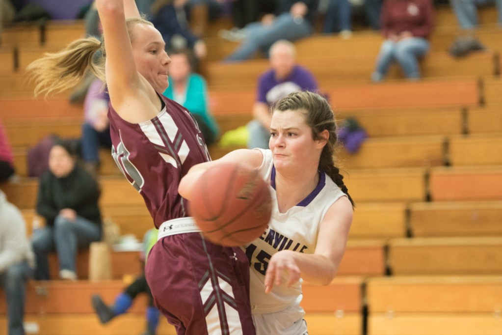 Waterville's Lindsay Given (15) looks to pass to an open teammate while Maine Central Institute's Sydney Morton defends her Wednesday night at Waterville Senior High School.