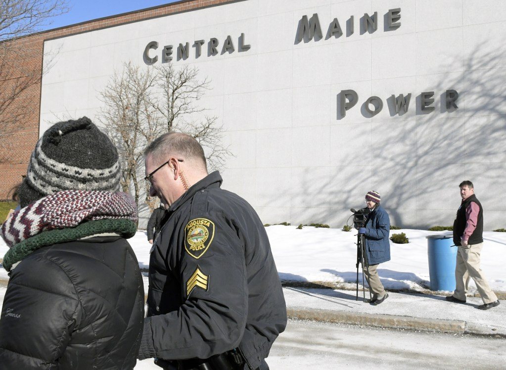 Augusta Police Dept. Sgt. Danny Boivin arrests a protester at Central Maine Power in Augusta on Monday.