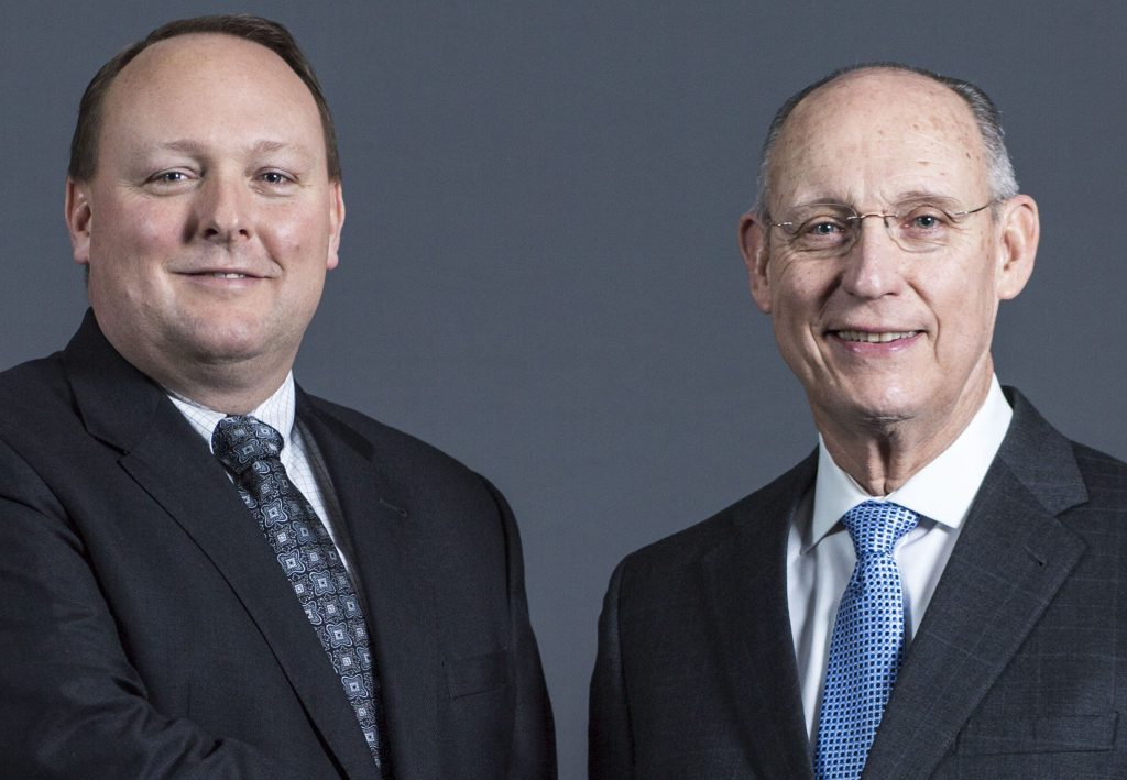 """Longtime Cianbro construction chief Peter Vigue is stepping down as CEO and handing the reins to his son, Peter """"Andi"""" Vigue."""