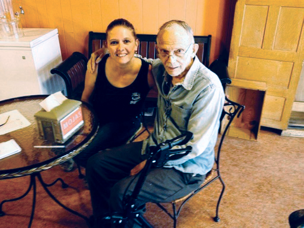 Jorgensen's Cafe owner Theresa Dunn poses with Vern Miller, a well-known figure in downtown Waterville who had his own booth in the cafe, where he spent all day counseling people and giving advice. Miller died Sunday at the age of 92.