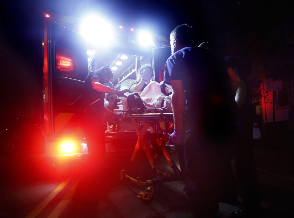 Portland Fire Department emergency crews use Narcan to revive a woman after a heroin overdose in 2015. City police officers have started carrying the antidote in response to an opioid epidemic that shows no signs of tapering off.