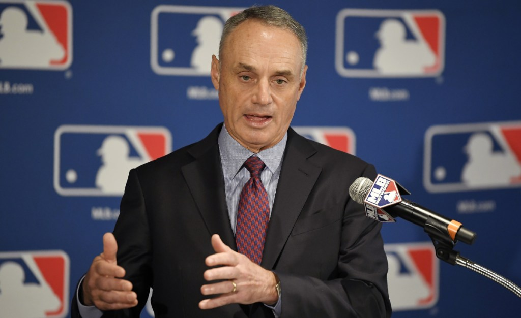 Major League Baseball Commissioner Rob Manfred says there will be a pitch clock in 2019 if the average time of a nine-inning game is higher than 2:55 this year.