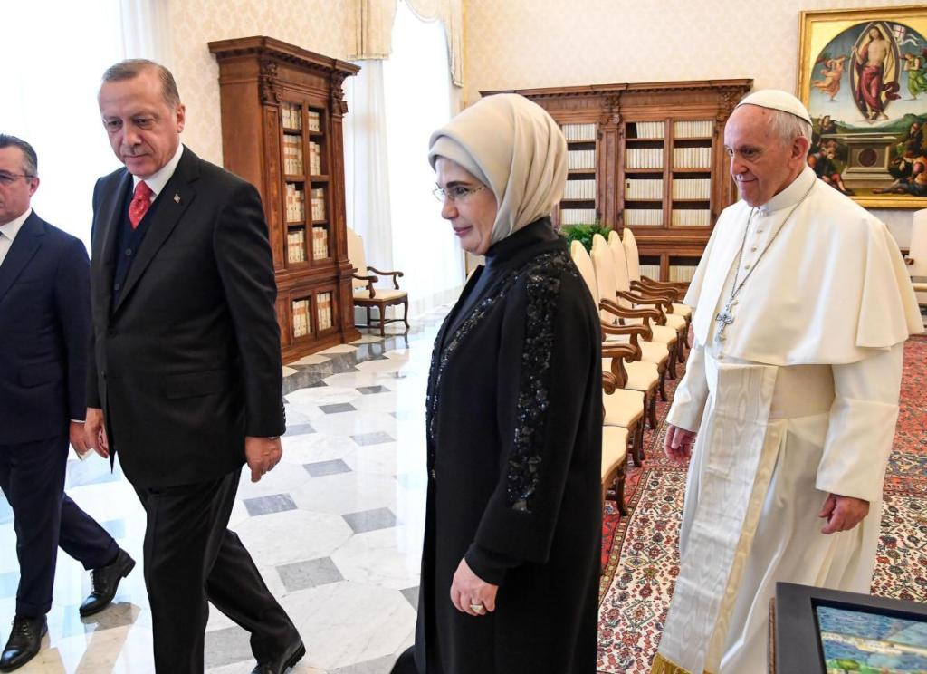 Turkish President Recep Tayyip Erdogan, left, and his wife, Emine, center, meet Pope Francis at the Vatican on Monday. Erdogan is the first Turkish president to visit the Vatican in nearly six decades. Francis met with him during his 2014 trip to Istanbul.