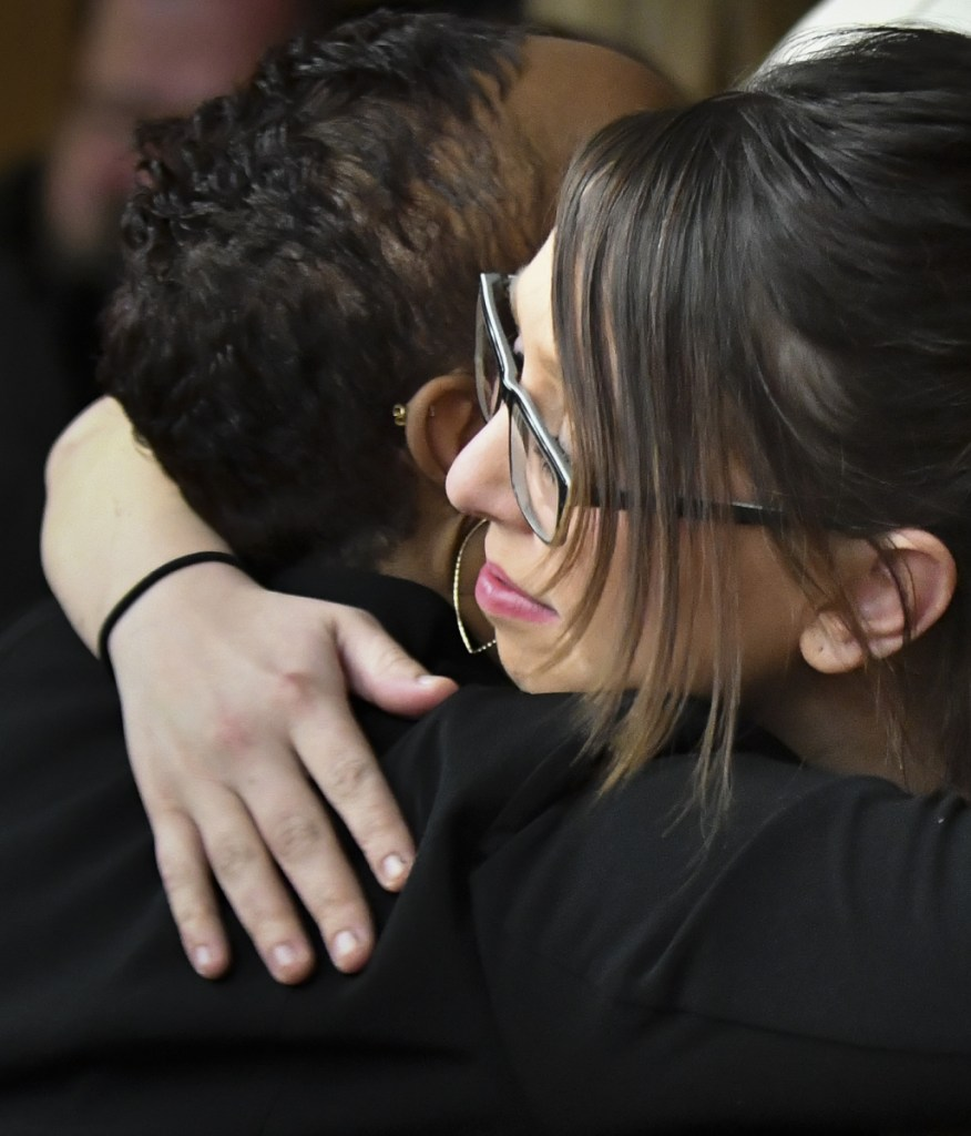 Former gymnast Ashley Erickson hugs assistant prosecutor Robyn Liddell Monday, after the third and final day of Larry Nassar's sentencing in Eaton County Court in Charlotte, Mich.
