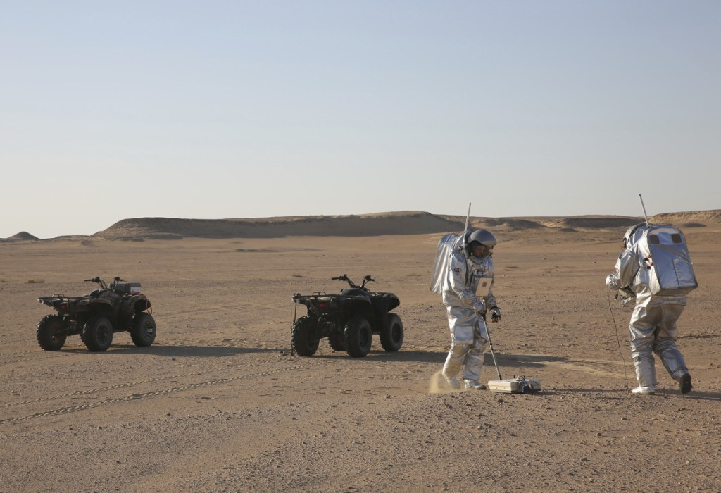 Scientists test space suits and a geo-radar, above, for use in a future Mars mission in the Dhofar desert of southern Oman. At left, Gernot Groemer, commander of the AMADEE-18 Mars simulation, stands among the inflated buildings of the Oman Mars Base.