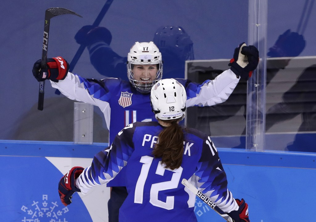 Jocelyne Lamoureux-Davidson (17), of the United States, celebrates her second goal against the team from Russia with Kelly Pannek (12) during the second period.