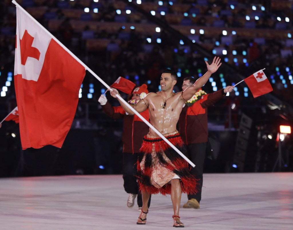 Pita Taufatofua carries the flag of Tonga during the opening ceremony of the 2018 Winter Olympics in Pyeongchang, South Korea on Friday.