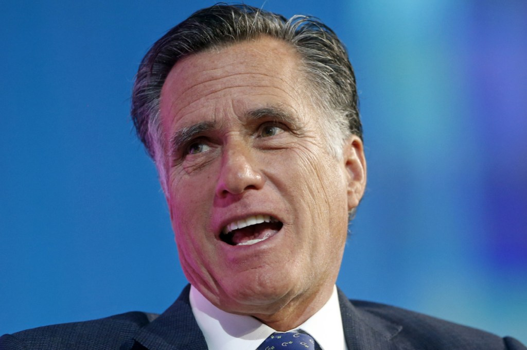 FILE - In this Jan. 19, 2018, file photo, former Republican presidential candidate Mitt Romney speaks about the tech sector during an industry conference dubbed Silicon Slopes, the nickname for Utah's burgeoning cluster of tech companies, in Salt Lake City. Romney is trying for a political comeback as he launches a Senate campaign in Utah.  (AP Photo/Rick Bowmer)